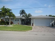 Example of a Cape Coral Gulf access waterfront home in the Cape Coral Yacht Club neighborhood behind a bridge